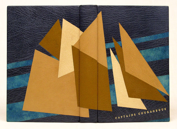 A design binding for Captain's Courageous in full leather, depicting the sail pattern of a New England fishing schooner.