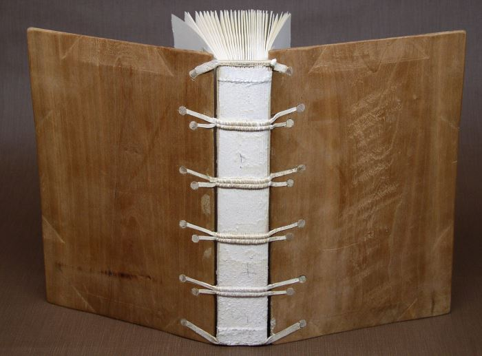 medieval book bound in wooden boards