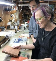 Taff and Jack Fitterer in the bindery