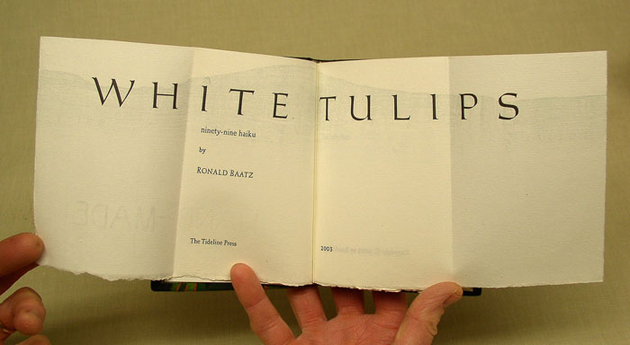 The title page of White Tulips by Ronald Baatz is a double gate-fold, being four pages wide.
